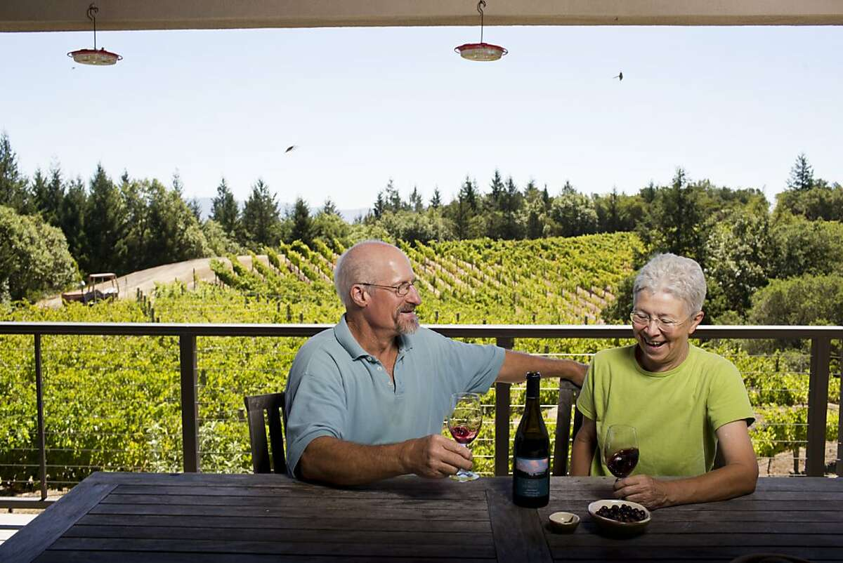 Carole Meredith and Steve Lagier, of Lagier Meredith Vineyards, have a variety of fruit trees growing on there property, including apples, blackberries, and olives on Mount Veeder in Napa, Calif., Thursday, August 15, 2013. Here Steve and Carole with a bottle of their 2009 Syrah.