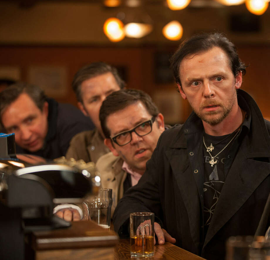 "Nick Frost (center) and Simon Pegg (right) star in ""The World's End,"" an examination of friends reliving a supposedly great night from their past."
