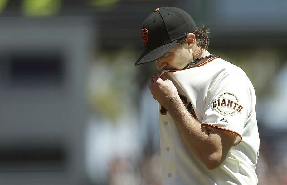 San Francisco Giants pitcher Barry Zito walks toward the dugout after being relieved during the fourth inning of a baseball game against the Boston Red Sox in San Francisco, Wednesday, Aug. 21, 2013. (AP Photo/Jeff Chiu) Photo: Jeff Chiu, Associated Press