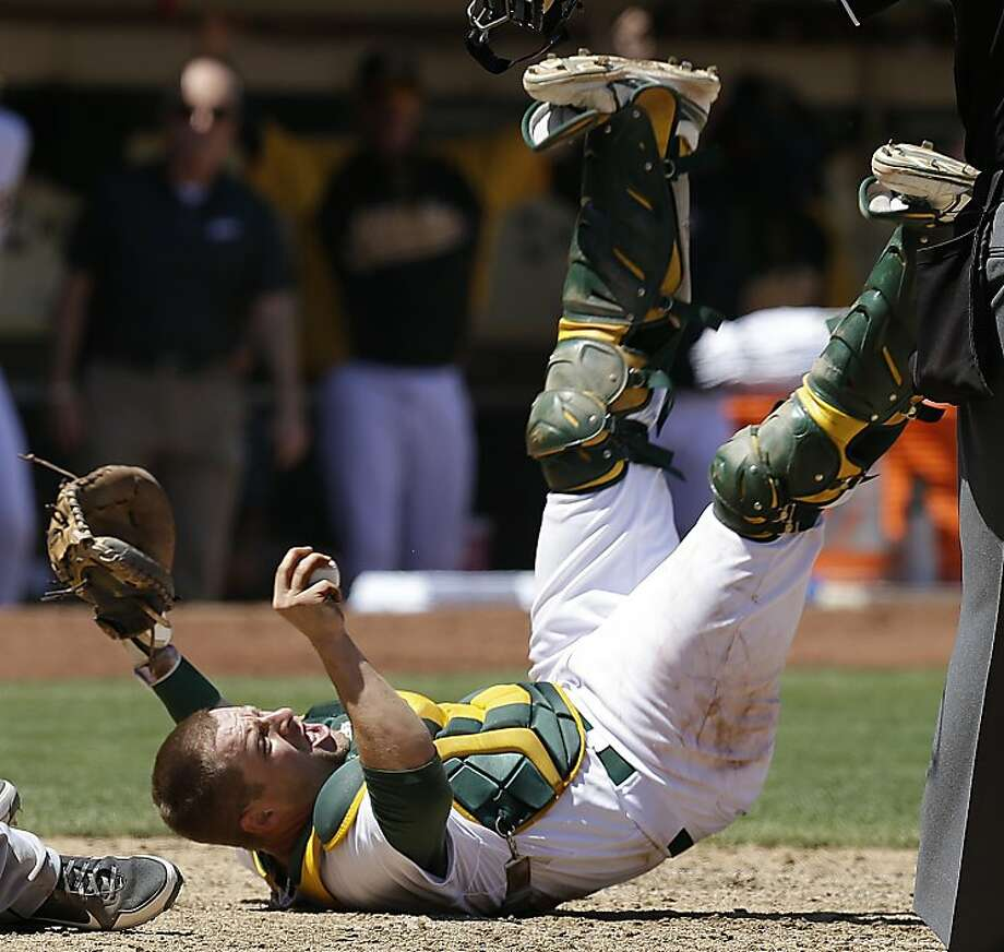 Oakland Athletics catcher Stephen Vogt reacts after Seattle Mariners' Dustin Ackley is called safe at home plate in the sixth inning of a baseball game Wednesday, Aug. 21, 2013, in Oakland, Calif. (AP Photo/Ben Margot) Photo: Ben Margot, Associated Press