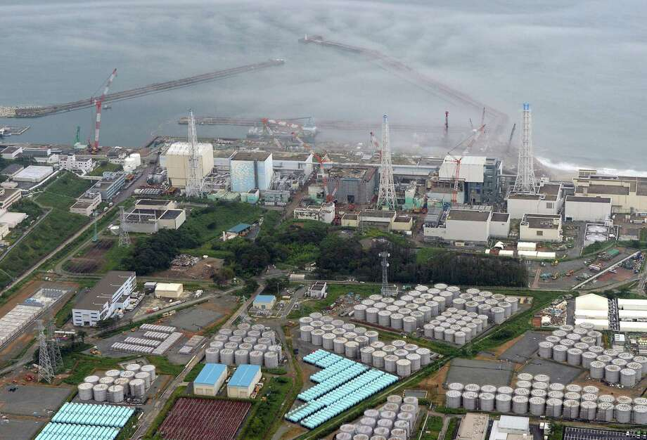 The round structures at the Fukushima Dai-ichi plant are storage tanks for contaminated water. Photo: SUB / Kyodo News