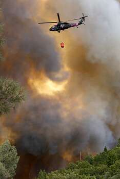 Helicopters were out in force making water drops along Ferretti Rd. in Groveland, Calif., as the 16,000 acre Rim Fire continues to grow on Wednesday August 21, 2013. Photo: Michael Macor, San Francisco Chronicle