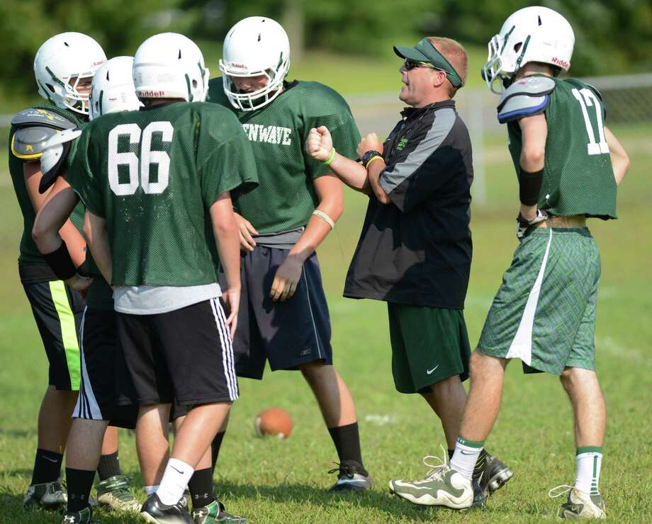 New Milford head football coach John Murphy instructs players at football practice at New Milford High School in New Milford, Conn. on Wednesday, Aug. 21, 2013.  Murphy is filling in as the new head coach this year.  A former state champion coach at Masuk High School, Murphy hopes to improve the New Milford football program. Photo: Tyler Sizemore / The News-Times