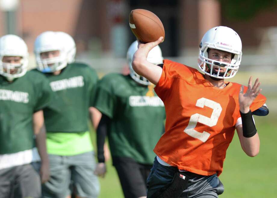 New Milford quarterback Jamie Portuntao throws during football practice at New Milford High School in New Milford, Conn. on Wednesday, Aug. 21, 2013.  John Murphy is filling in as the new head coach this year.  A former state champion coach at Masuk High School, Murphy hopes to improve the New Milford football program. Photo: Tyler Sizemore / The News-Times