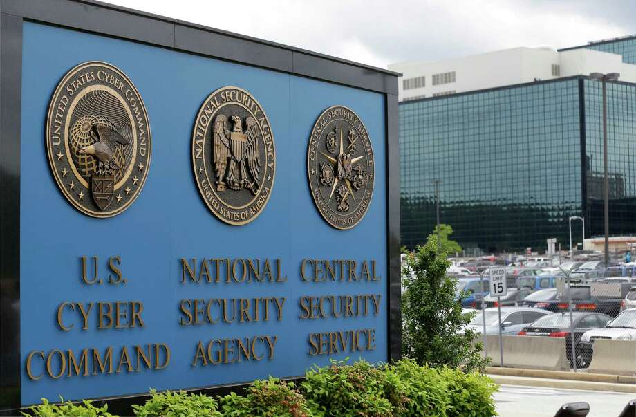 FILE - This June 6, 213 file photo shows the sign outside the National Security Agency (NSA) campus in Fort Meade, Md. The National Security Agency declassified three secret U.S. court opinions Wednesday, Aug. 21, 2013, showing how it scooped up as many as 56,000 emails and other communications by Americans with no connection to terrorism annually over three years, how it revealed the error to the court and changed how it gathered Internet communications. Photo: Patrick Semansky