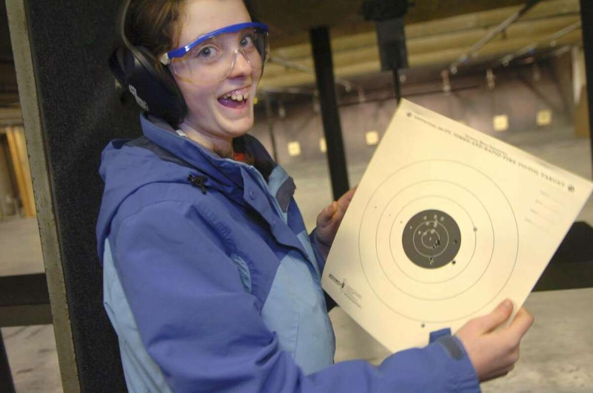 """Greenwich, Jan. 10, 2010. Kelly Martise, 14, from the """"High School Troup"""", celebrates her success at the target practice with 22 caliber rifles at the Cos Cob Revolver and Rifle Club, one of the Troup's events."""