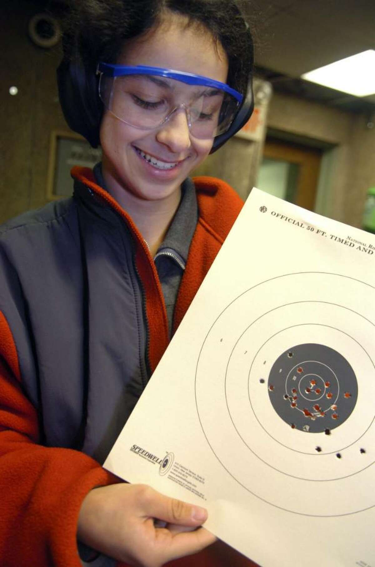 Greenwich, Jan. 10, 2010. Girls scout Alicia King, 15, looks at her target during the troup event at Cos Cob Revolver and Rifle Club. They learned safety and target practice with 22 caliber rifles.