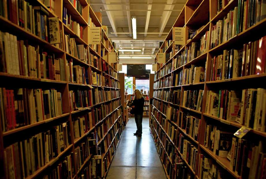 Portland's biggest tourist draw is Powell's Books. We dig books, but it's no Space Needle or Pike Place or Ballard Locks … Photo: George Rose, Multiple / 2012 George Rose