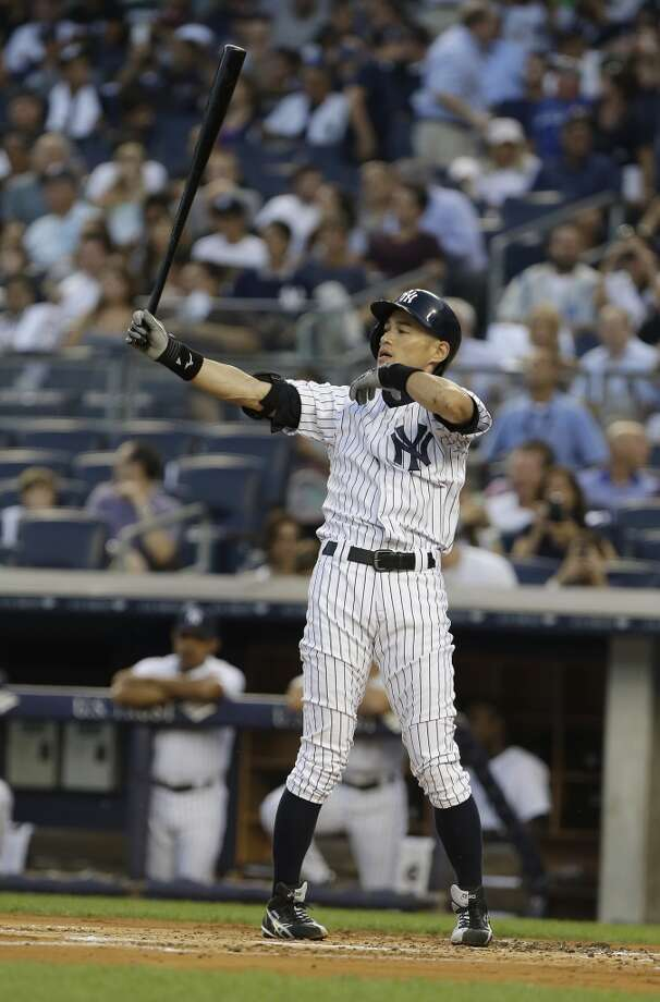 Ichiro Suzuki, of the New York Yankees, stretches before the at-bat in which he recorded his 4,000th professional hit Wednesday at Yankee Stadium. Photo: Frank Franklin II, Associated Press