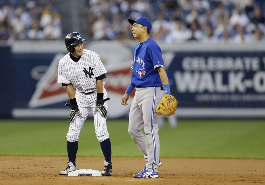 Ichiro Suzuki, left, chats with fellow former Mariners player Munenori Kawasaki, now on the Toronto Blue Jays, on Wednesday after Suzuki recorded his 4,000th hit in New York. Photo: Kathy Willens, Associated Press