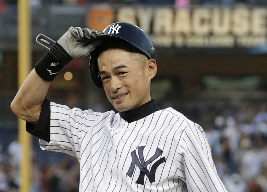 Ichiro Suzuki tips his helmet after connecting for his 4,000th career hit in Japan and the major leagues Wednesday at Yankee Stadium. Photo: Kathy Willens, Associated Press