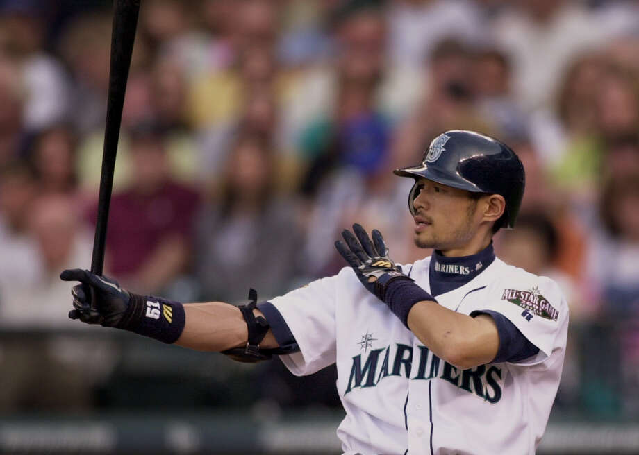 Seattle Mariners' Ichiro Suzuki takes aim with his bat on May 31, 2001, in Seattle. Photo: Elaine Thompson, Associated Press / AP