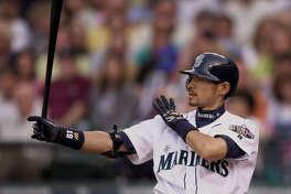 Seattle Mariners' Ichiro Suzuki takes aim with his bat on May 31, 2001, in Seattle.