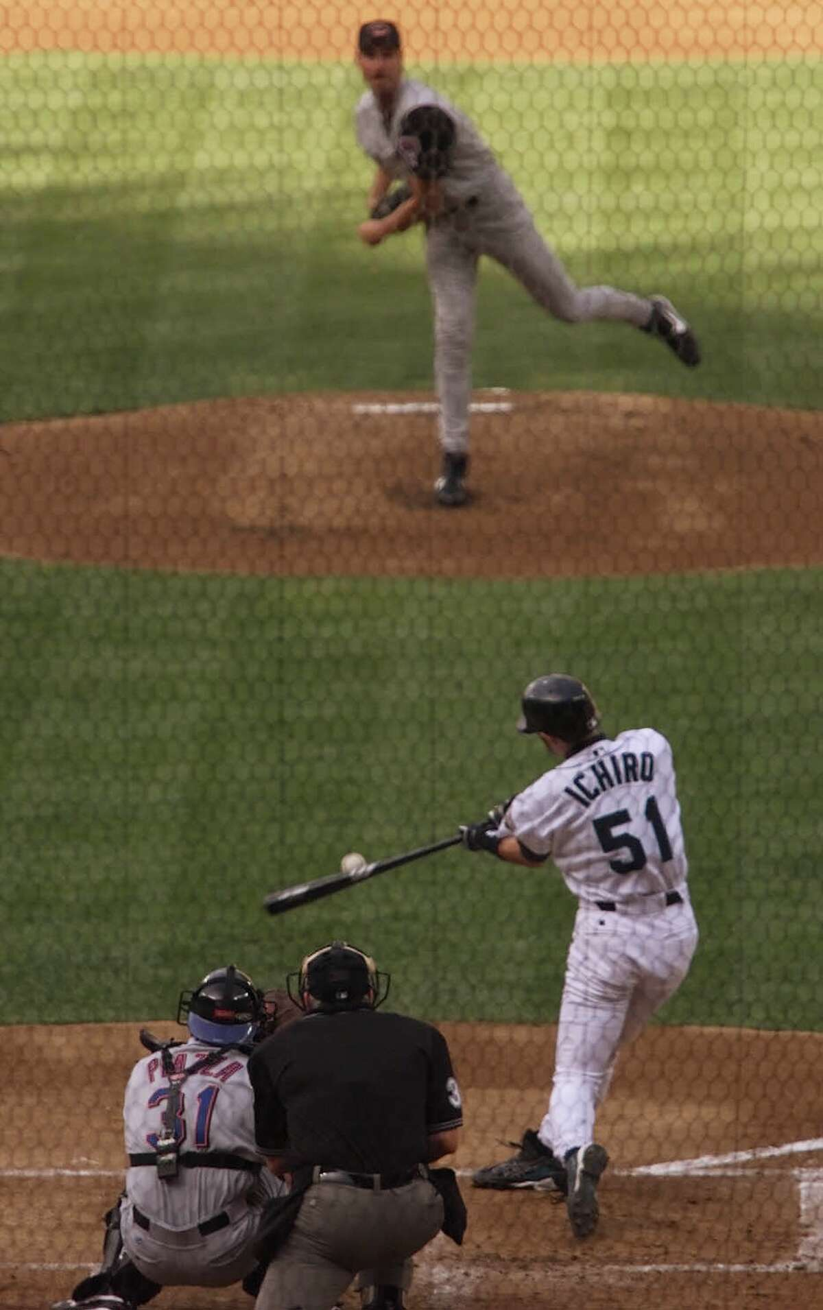 Ichiro Suzuki connects for a hit off Randy Johnson in his first at bat during the All Star Game on July 10, 2001 at Safeco Field.