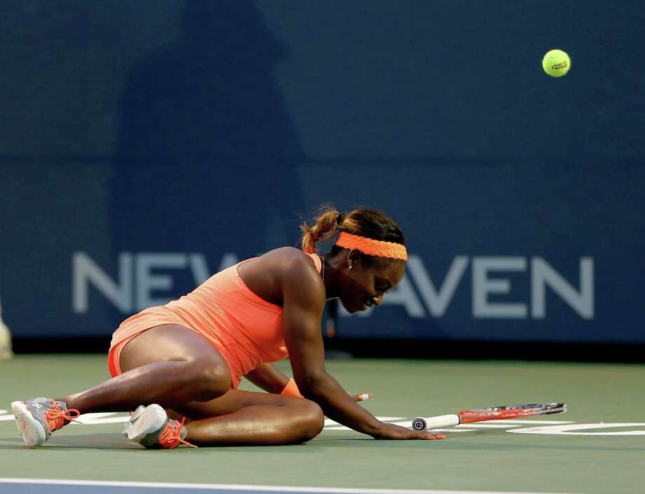 NEW HAVEN, CT - AUGUST 21:  Sloane Stephens of the USA trips while trying to return a shot to Julia Goerges of Germany during Day Four of the New Haven Open at Connecticut Tennis Center at Yale on August 21, 2013 in New Haven, Connecticut. Photo: Elsa, Getty Images / 2013 Getty Images