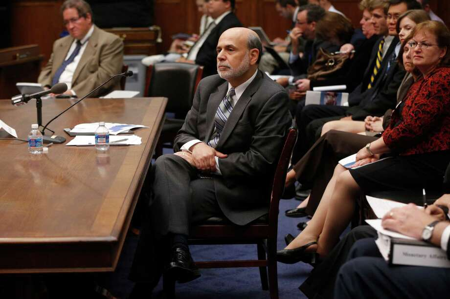 FILE - In this Wednesday, July 17, 2013, file photo, chairman of the Federal Reserve Ben Bernanke testifies in Washington. The Federal Reserve appears on track to slow its bond purchases by the end of this year if the economy continues to improve. But it remains divided over the exact timing of the move.  That's the message from the minutes of the Fed's July 30-31 meeting released Wednesday, Aug. 21, 2013.  (AP Photo/Charles Dharapak) Photo: Charles Dharapak, STF / AP
