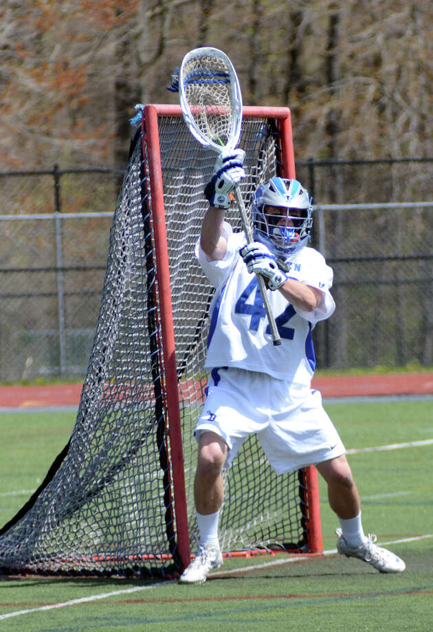 Darien's Phil Huffard (42) defends the goal during the East meets West lacrosse invitational against Torrey Pines California at Darien High School on Saturday, Apr. 14, 2012. Photo: Amy Mortensen / Stamford Advocate Freelance