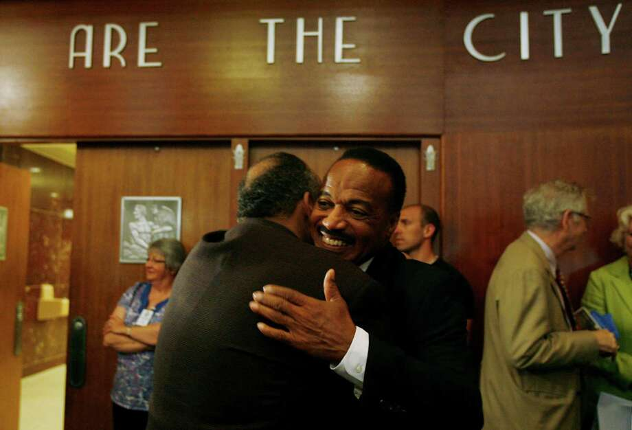 George Vallery, former high school teammate, embraces Jerry Levias, Community Outreach Director for the Boys and Girls Harbor and former college football player, on the day he is honored by Mayor Annise Parker at City Hall on Tuesday, May 4, 2010, in Houston. Photo: Mayra Beltran, Houston Chronicle / Houston Chronicle