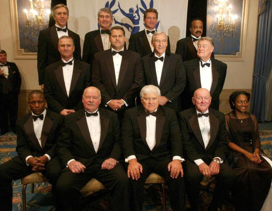 College football Hall of Fame players and coaches pose for a picture at the Waldorf-Astoria hotel in New York Tuesday, Dec. 9, 2003. They are: (top row from left) Roger Wehrli, Murry Bowden, Joe Theismann, Jerry LeVias, (second row) Ron Pritchard, Jimbo Covet, Doug Dickey, Hayden Fry, (front row) Barry Sanders, Tom Brown, Billy Neighbors, John Rauch, Jackie Bell (for Ricky Bell). The  eleven players and two coaches are to be inducted into the College Football Hall of Fame in a ceremony tonight. Photo: GREGORY BULL, ASSOCIATED PRESS / AP2003