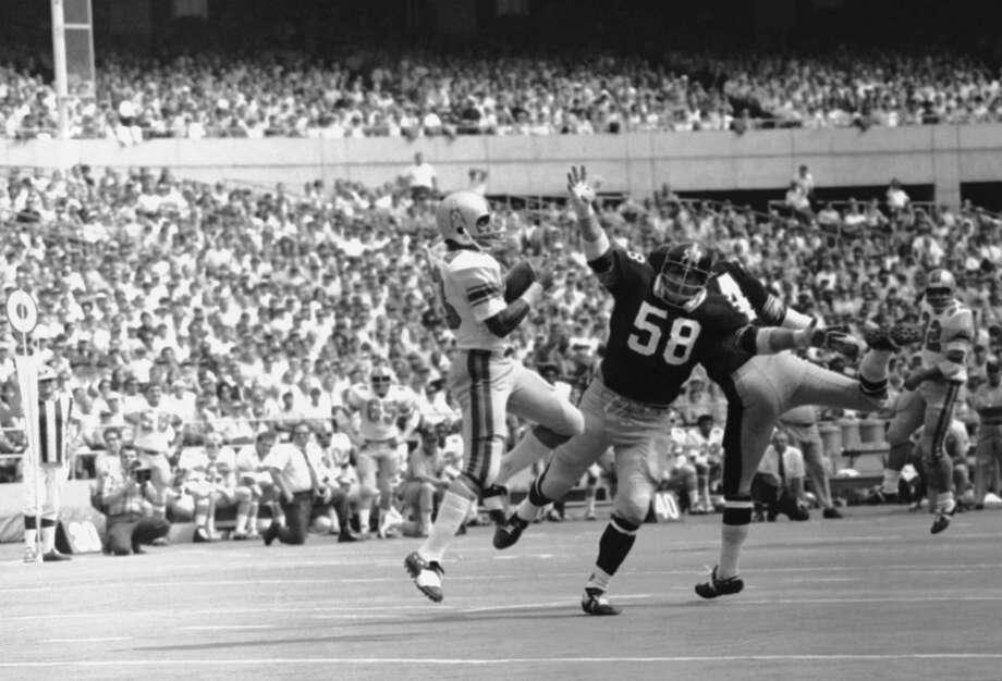 Houston Oilers wide receiver Jerry Levias (23) latches onto pass from quarterback Charley Johnson good for 22 yards and first TD in first quarter action in afternoon on Sunday, Sept. 21, 1970 in Pittsburgh. In on play are Steelers Linebackers Chuck Allen (58) and Andy Russell (34).   Oilers won it 19-7. Photo: HARRY CABLUCK, AP / 1970 AP