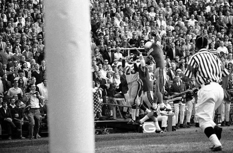 Mike Sensibaugh (3), Ohio State, defender, gets his fingers on this pass intended for Southern Methodist end Jerry Levias (23), but the ball fell dead in first quarter of non-Conference football game on Sept. 28, 1968 in Columbus, Ohio. Stateís Mike Polaski (15) also gets in the act. Photo: Gen, ASSOCIATED PRESS / AP1968