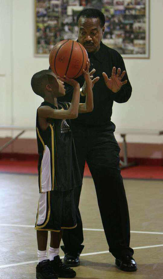 Jerry LeVias, Boys & Girls Harbor Outreach Director, listens to Marcus Collins, 12, on how to do free throws in the gym at Boys & Girls Harbor on Tuesday, Dec. 9, 2008, in La Porte. Photo: Mayra Beltran, Houston Chronicle / Houston Chronicle