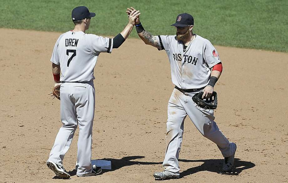 Boston Red Sox shortstop Stephen Drew (7) and left fielder Jonny Gomes celebrate after they defeated the San Francisco Giants in a baseball game in San Francisco, Wednesday, Aug. 21, 2013. The Red Sox won 12-1. (AP Photo/Jeff Chiu) Photo: Jeff Chiu, Associated Press