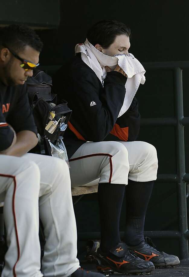 San Francisco Giants pitcher Barry Zito, right, sits in the dugout after being relieved during the fourth inning of a baseball game against the Boston Red Sox in San Francisco, Wednesday, Aug. 21, 2013. (AP Photo/Jeff Chiu) Photo: Jeff Chiu, Associated Press