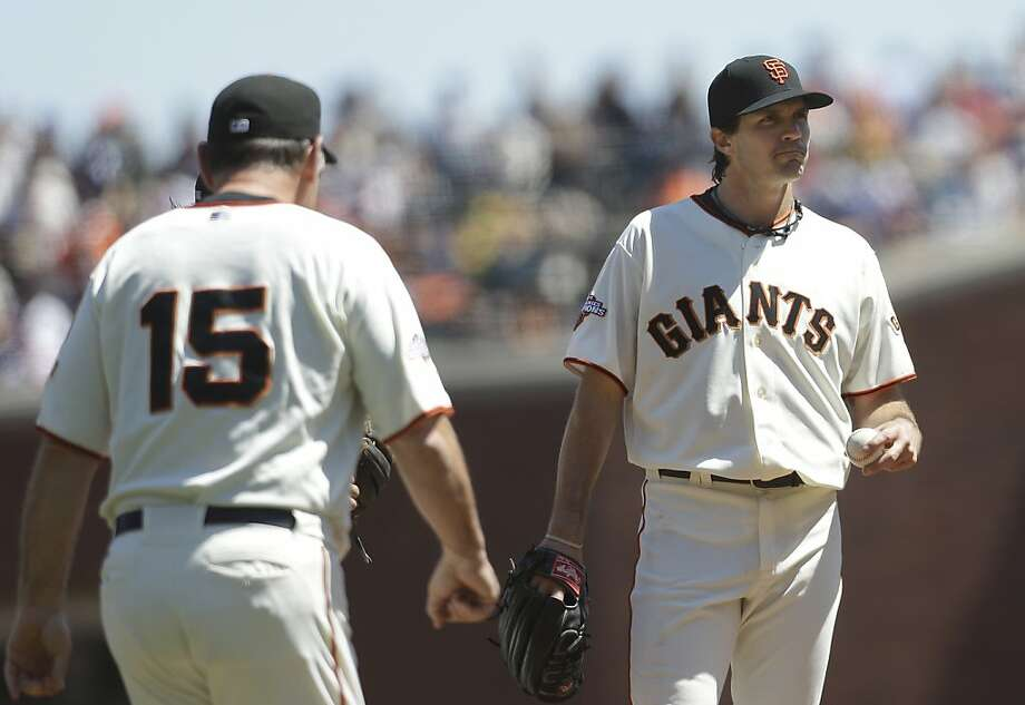 San Francisco Giants manager Bruce Bochy (15) walks toward the mound to relieve pitcher Barry Zito during the fourth inning of a baseball game against the Boston Red Sox in San Francisco, Wednesday, Aug. 21, 2013. (AP Photo/Jeff Chiu) Photo: Jeff Chiu, Associated Press