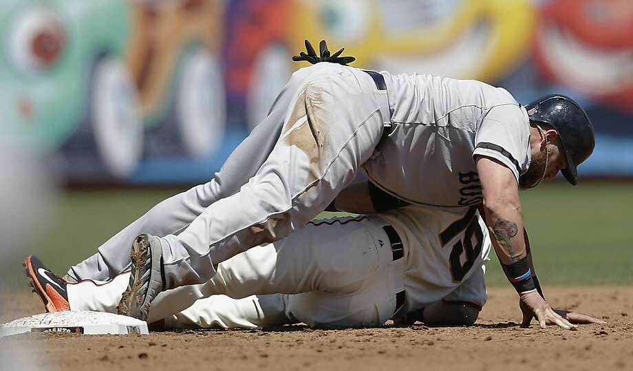 Boston Red Sox's Jonny Gomes lies on top of San Francisco Giants second baseman Marco Scutaro (19) after being tagged out by Scutaro during the third inning of a baseball game in San Francisco, Wednesday, Aug. 21, 2013. (AP Photo/Jeff Chiu) Photo: Jeff Chiu, Associated Press