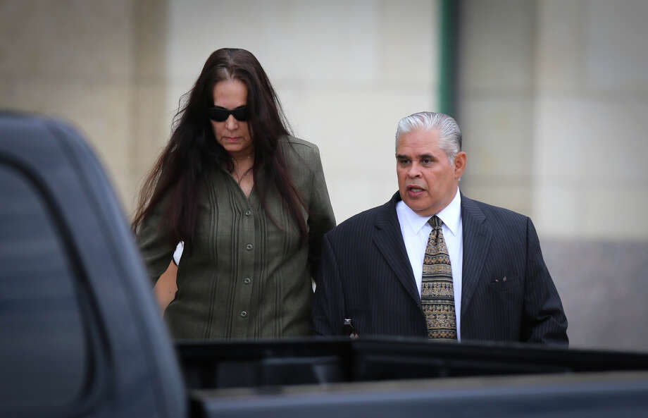 Former 404th state District Judge Abel Limas, right, quickly exits the federal courthouse in Brownsville, Texas on Wednesday, Aug. 21, 2013. Photo: Yvette Vela, Associated Press / The Brownsville Herald
