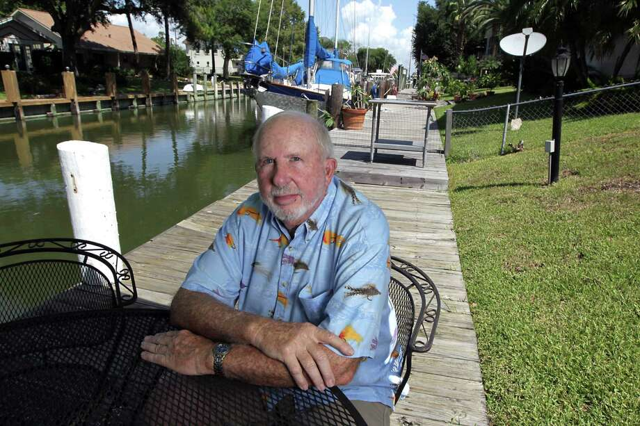 Jack Boze, a retired NASA executive, is having trouble selling his home in Kemah because flood insurance has increased. Photo: James Nielsen, Staff / © 2013  Houston Chronicle