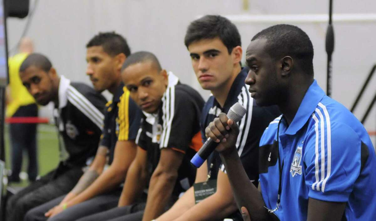 American soccer player and Newtown resident, Marcus Tracy, right, answers questions at the Soccer Night in Newtown on Monday Jan. 7, 2013. From left American soccer players Corey Ashe, Sean Franklin, Ricardo Clark and Omar Salgado.