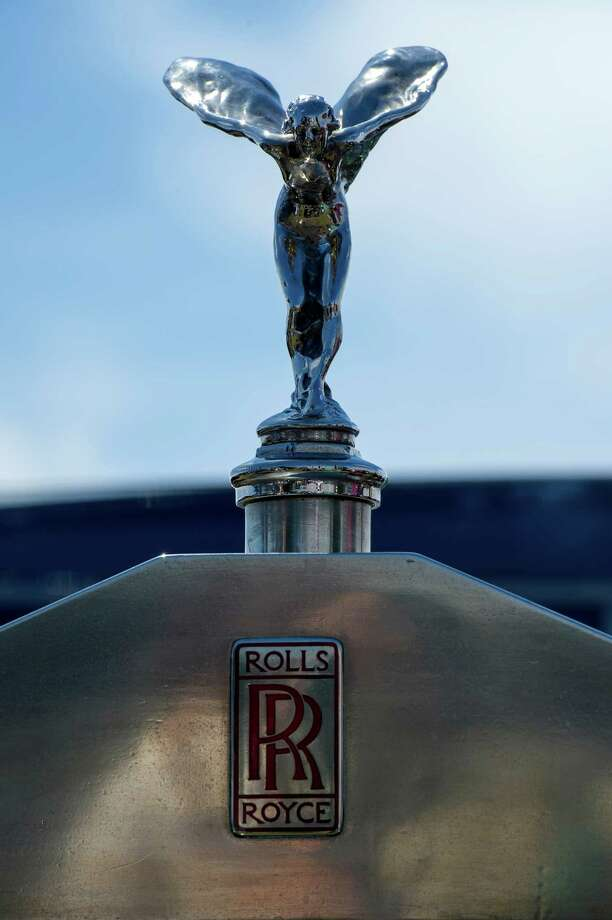 The hood ornament of the 1933 Rolls-Royce Phantom II Streamline Saloon is displayed during the 2013 Pebble Beach Concours d' Elegance in Pebble Beach, California, U.S., on Sunday, Aug. 18, 2013. The annual event in its 63rd year raised $1.277 million U.S. dollars for charity and showcased 248 cars, 48 from abroad. Photo: David Paul Morris, Bloomberg / 2013 Bloomberg Finance LP