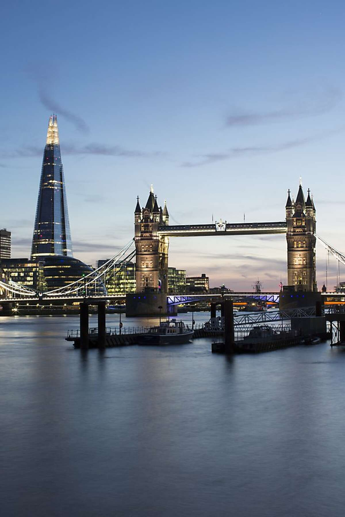 The Shard and Tower Bridge at sunset in London.