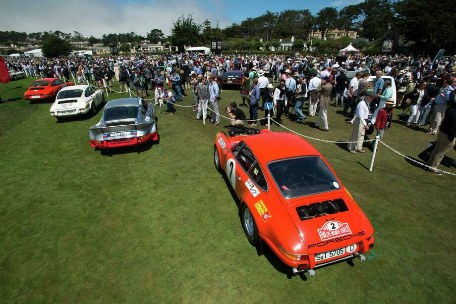 Porsche 911 road cars are displayed during the 2013 Pebble Beach Concours d' Elegance in Pebble Beach, California, U.S., on Sunday, Aug. 18, 2013. The annual event in its 63rd year raised $1.277 million U.S. dollars for charity and showcased 248 cars, 48 from abroad. Photo: David Paul Morris, Bloomberg / 2013 Bloomberg Finance LP