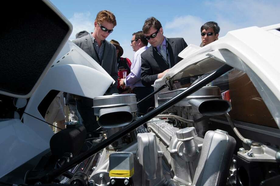 Attendees look at the engine of a 1966 Lamborghini Miura P400 Prototype Bertone Coupe during the 2013 Pebble Beach Concours d' Elegance in Pebble Beach, California, U.S., on Sunday, Aug. 18, 2013. The annual event in its 63rd year raised $1.277 million U.S. dollars for charity and showcased 248 cars, 48 from abroad. Photo: David Paul Morris, Bloomberg / 2013 Bloomberg Finance LP