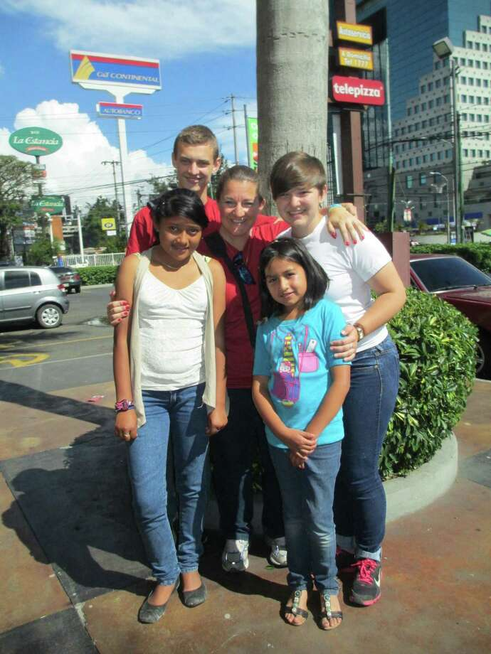 Will, Mindy and Alex Whisenhunt pose with their Guatemalan sponsor daughters, Irma, 13, and Melany, 9. (Mindy Whisenhunt)