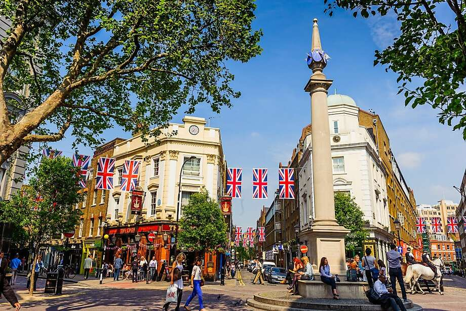 The sundial is a popular spot for relaxing and people-watching in London's Seven Dials neighborhood, which was once a slum but is now an urban getaway. Photo: Threepipe