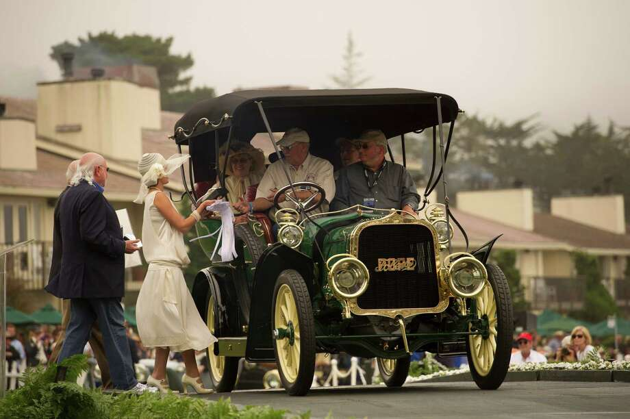The 1906 Pope-Toledo Type XII Roi des Belges 7 passenger Touring car is driven during the 2013 Pebble Beach Concours d' Elegance in Pebble Beach, California, U.S., on Sunday, Aug. 18, 2013. The annual event in its 63rd year raised $1.277 million U.S. dollars for charity and showcased 248 cars, 48 from abroad. Photo: David Paul Morris, Bloomberg / 2013 Bloomberg Finance LP