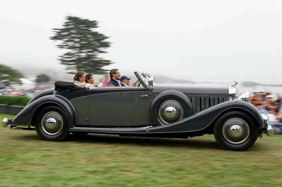 Sir Michael Kadoorie of Hong Kong drives his 1934 Hispano Suiza J12 Vanvooren Coupe during the 2013 Pebble Beach Concours d' Elegance in Pebble Beach, California, U.S., on Sunday, Aug. 18, 2013. The annual event in its 63rd year raised $1.277 million U.S. dollars for charity and showcased 248 cars, 48 from abroad. Photo: David Paul Morris, Bloomberg / 2013 Bloomberg Finance LP