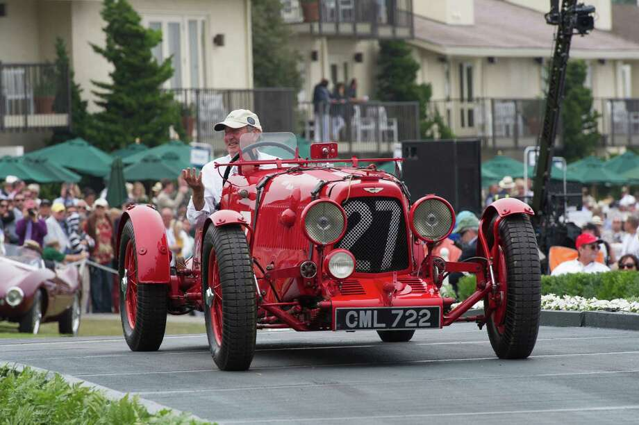 Nick Mason, drummer for the band Pink Floyd, drives his 1935 Aston Martin Ulster race car during the 2013 Pebble Beach Concours d' Elegance in Pebble Beach, California, U.S., on Sunday, Aug. 18, 2013. The annual event in its 63rd year raised $1.277 million U.S. dollars for charity and showcased 248 cars, 48 from abroad. Photo: David Paul Morris, Bloomberg / 2013 Bloomberg Finance LP