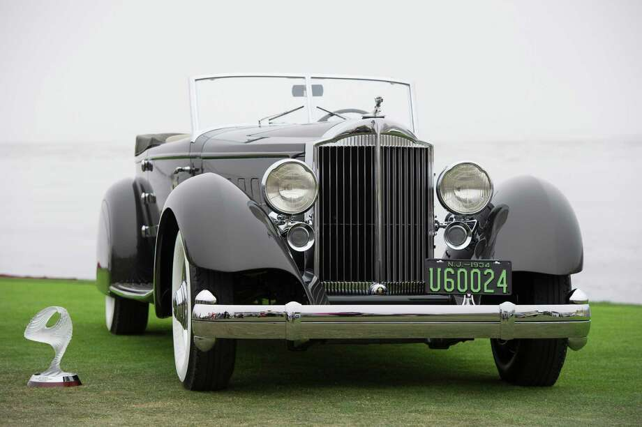 The 1934 Packard 1108 Twelve Dietrich Convertible Victoria is displayed for a photograph after being awarded the Best Of Show during the 2013 Pebble Beach Concours d' Elegance in Pebble Beach, California, U.S., on Sunday, Aug. 18, 2013. The annual event in its 63rd year raised $1.277 million U.S. dollars for charity and showcased 248 cars, 48 from abroad. Photo: David Paul Morris, Bloomberg / 2013 Bloomberg Finance LP