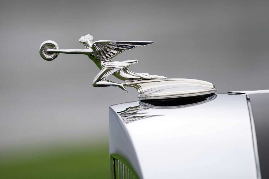 The hood ornament of the 1934 Packard 1108 Twelve Dietrich Convertible Victoria is displayed for a photograph after being awarded the Best Of Show during the 2013 Pebble Beach Concours d' Elegance in Pebble Beach, California, U.S., on Sunday, Aug. 18, 2013. The annual event in its 63rd year raised $1.277 million U.S. dollars for charity and showcased 248 cars, 48 from abroad. Photo: David Paul Morris, Bloomberg / 2013 Bloomberg Finance LP