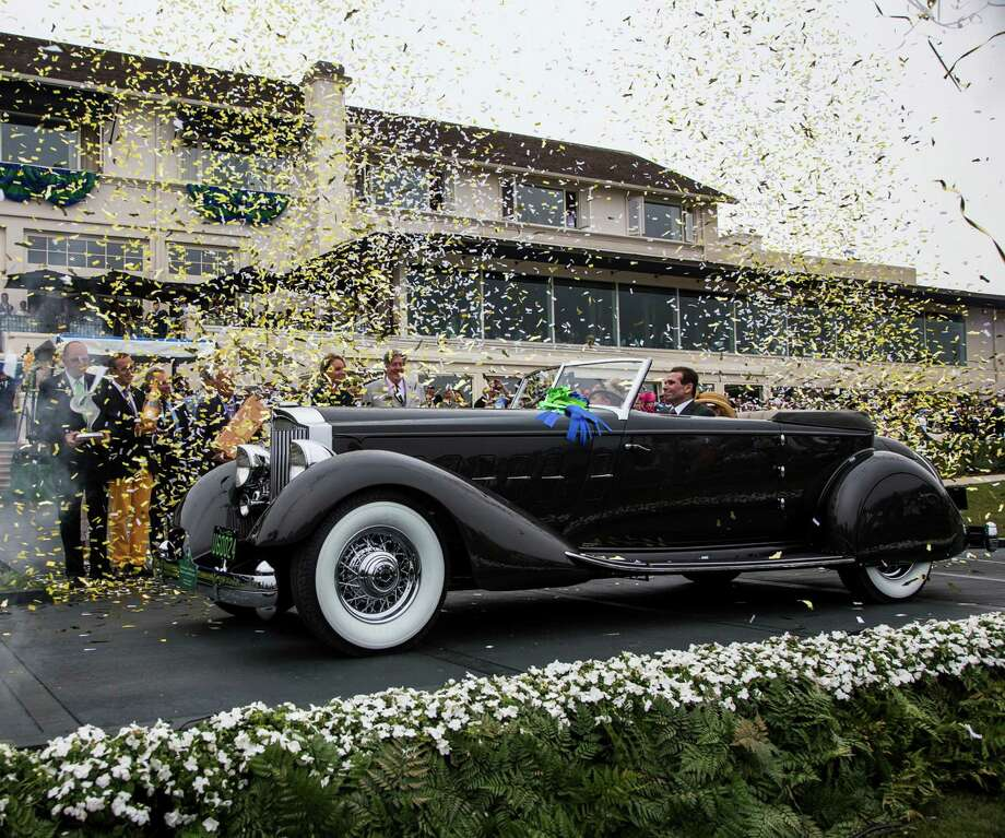 "In a photo provided by Rolex, the 1934 Packard 1108 Twelve Dietrich Convertible Victoria, owned by Joseph & Margie Cassini III, from West Orange, New Jersey, took the ""Best of Show Award"" at the Pebble Beach Concours d'Elegance in Pebble Beach, Calif., on Sunday, Aug. 18, 2013. The event, part of Classic Car Week on California's Monterey Peninsula, aims to recognize and encourage proper preservation of the world's great automobiles, judging vehicles for their historical accuracy, technical merit, style and elegance. Photo: Tom O'Neal, Associated Press / ROLEX"
