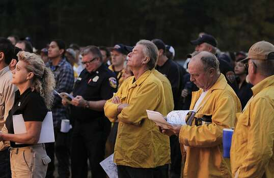 Firefighters attend the 6 a.m. morning briefing at the incident base camp  as the 16,000 acre Rim Fire continues to grow near Groveland, Ca., on Wednesday August 21, 2013. Photo: Michael Macor, San Francisco Chronicle