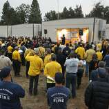 Firefighters attend the 6 a.m. morning briefing at the incident base camp  as the 16,000 acre Rim Fire continues to grow near Groveland, Ca., on Wednesday August 21, 2013.