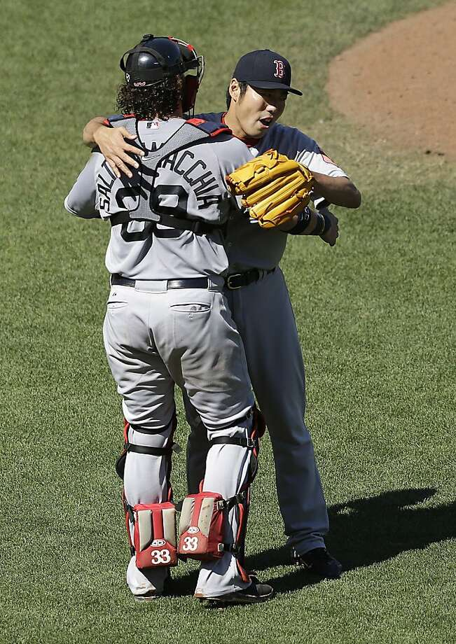 Boston Red Sox catcher Jarrod Saltalamacchia (39) and pitcher Koji Uehara (19), from Japan, celebrate after the Red Sox beat the San Francisco Giants in a baseball game in San Francisco, Wednesday, Aug. 21, 2013. (AP Photo/Jeff Chiu) Photo: Jeff Chiu, Associated Press