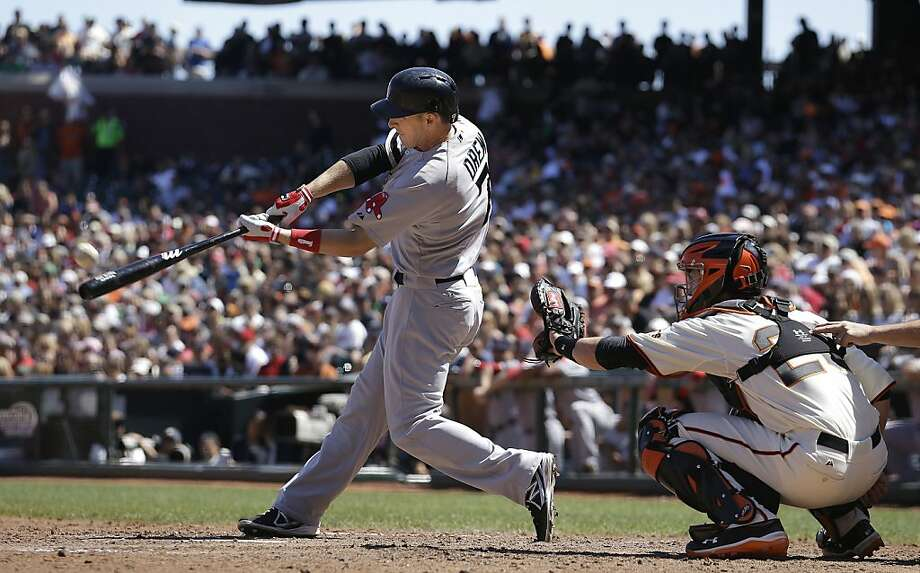 Boston Red Sox' Stephen Drew. left, hits a three-run home run off of San Francisco Giants pitcher Michael Kickham during the seventh inning of a baseball game in San Francisco, Wednesday, Aug. 21, 2013. Giants catcher Buster Posey looks on. (AP Photo/Jeff Chiu) Photo: Jeff Chiu, Associated Press