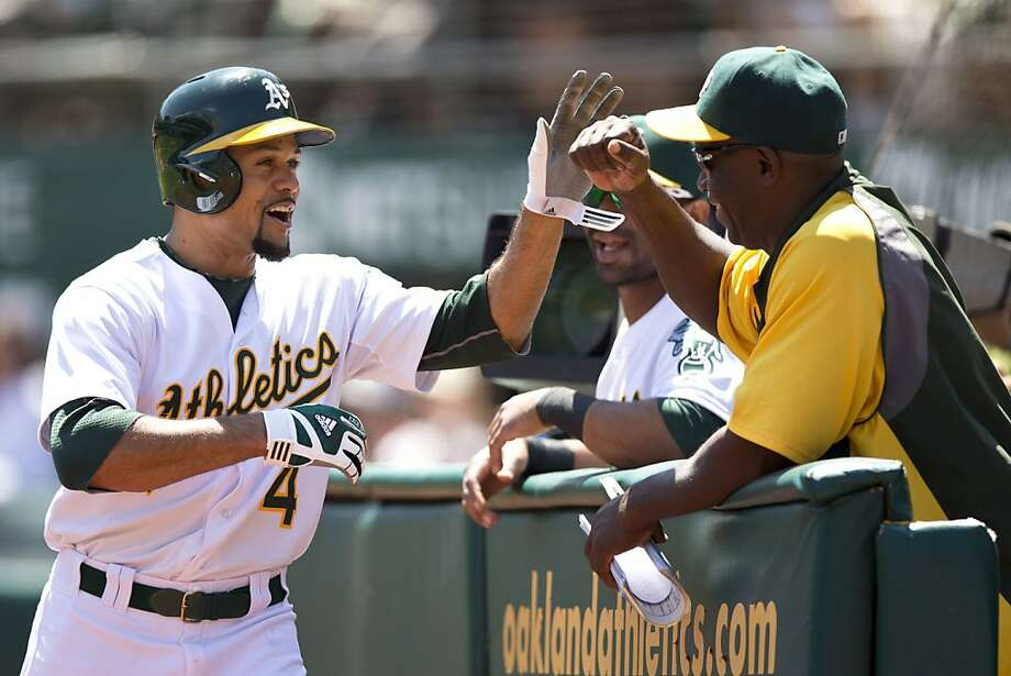 OAKLAND, CA - AUGUST 21: Coco Crisp #4 of the Oakland Athletics is congratulated by teammates in the dugout after hitting a home run against the Seattle Mariners during the first inning at O.co Coliseum on August 21, 2013 in Oakland, California. (Photo by Jason O. Watson/Getty Images) Photo: Jason O. Watson, Getty Images